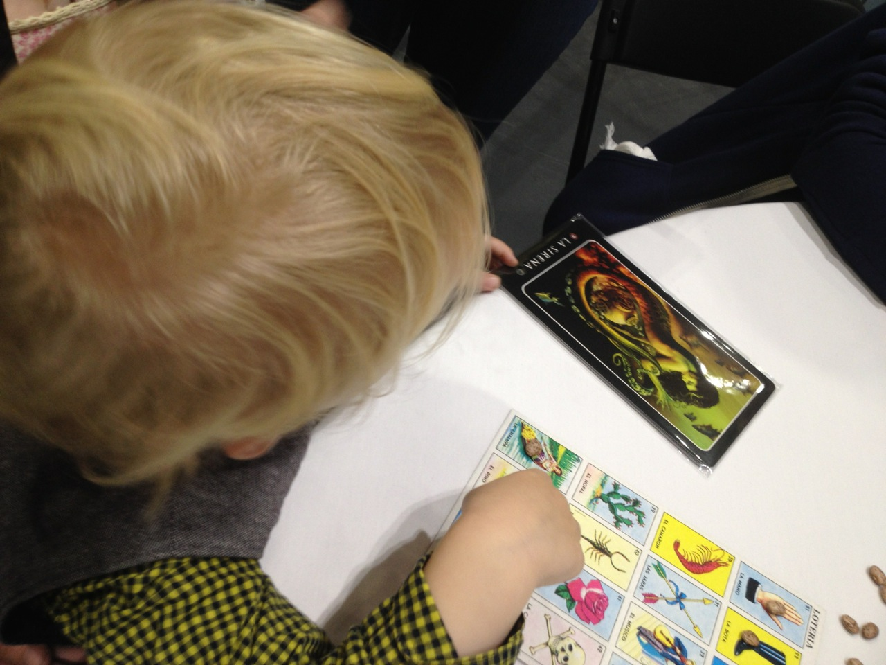 "At the Loteria demo on Sunday morning: this kid won one of the awesome prizes—a pack of six ""grande"" Loteria cards!"